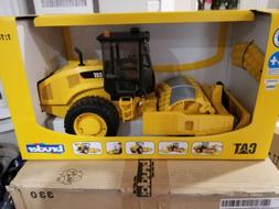Bruder Toys Cat Vibratory Soil Compactor with levelling Blad